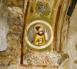 detail of a frescoed wall forming part of the fortified complex of Basignano, Puglia - Italy