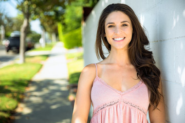 Beautiful brunette female head shot with perfect smile and healthy white teeth smiling