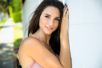 Cute adorable innocent sincere look from resting female girl next door type against wall