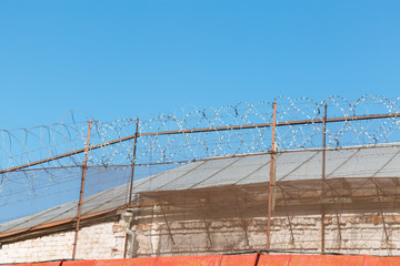 Barbed wire, fence and wall in prison