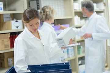 friendly pharmacist working in pharmacy