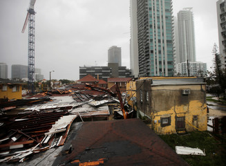 Destroyed roofs at a residential areas are seen as Hurricane Irma passes south Florida, in Miami
