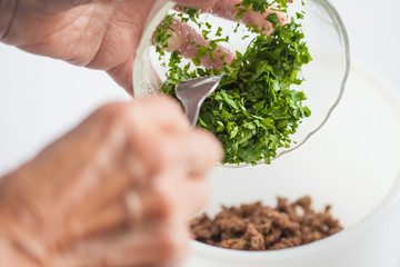 Step by step Levantine cuisine kibbeh preparation : Mixing the ingredients to prepare kibbeh filling into a bowl