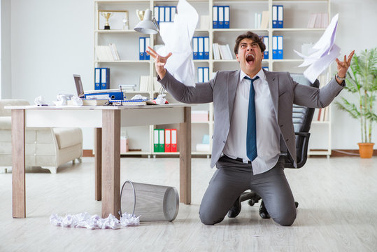 Angry businessman shocked working in the office fired sacked