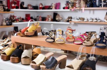 Picture of shelves with sandals in the shoes shop.