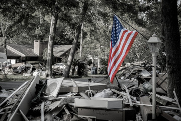 American Flag next to a pile of trash from a home that was hit by Hurricane Harvey