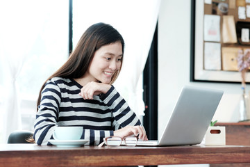 Young asian woman using laptop computer in casual lifestyles, people and technology, lifestyles