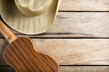 Guitars and hats on wooden table.