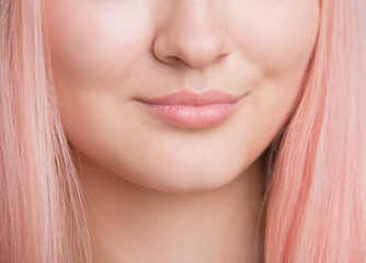 Closeup of female lips. Slightly smiling. No makeup