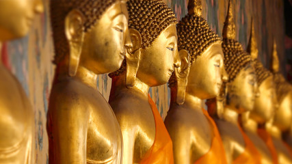 Golden Buddha Statues at Wat Arun in Bangkok, Thailand