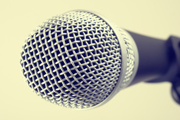 the classic vintage silver microphone on green background