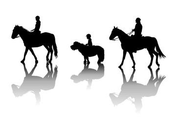 Family riding horses and pony