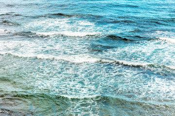 Vibrant sea waves hitting shore, abstract background