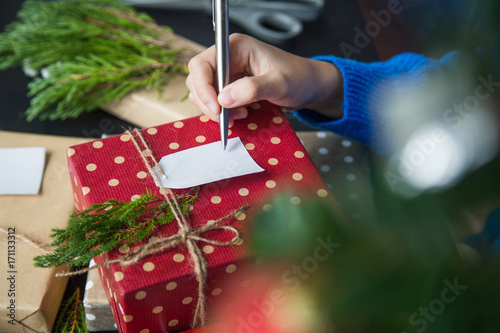 Write christmas greetings in a card and giving present for festival write christmas greetings in a card and giving present for festival m4hsunfo
