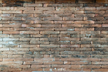 Grunge brown brick wall texture. Material construction.