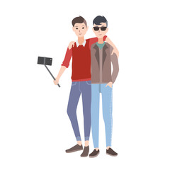 Two young men dressed in stylish clothing standing together, smiling and making selfie photo using monopod with smartphone. Flat cartoon characters isolated on white background. Vector illustration.