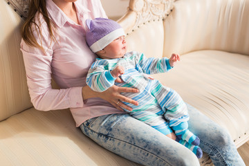 Lovely mother holding newborn baby in arms