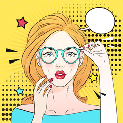 Pop art surprised woman face with open mouth in glasses. Comic woman with speech bubble. Vector illustration.