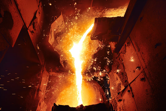 Cast iron and metal at the metallurgical plant. Molten metal in the furnace