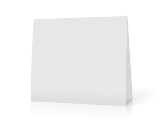A paper white calendar stands on the table. Mock Up Vector Template