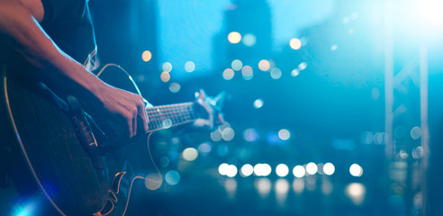 Guitarist on stage for background, soft and blur concept Wall mural