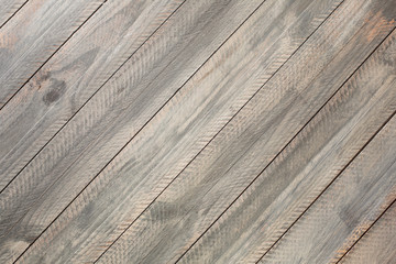 Gray rustic wooden background. Diagonal borders orientation