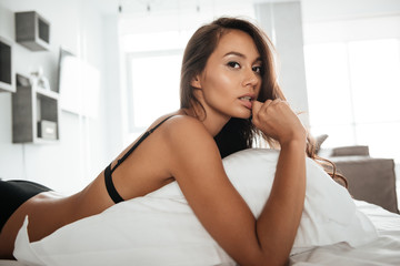 Portrait of a young sensual asian woman in sexy underwear