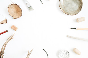 Layout with copy space made of goat horns, handmade plate, coconut, tools for handmade arts on white background. Top view, flat lay hipster artist concept.