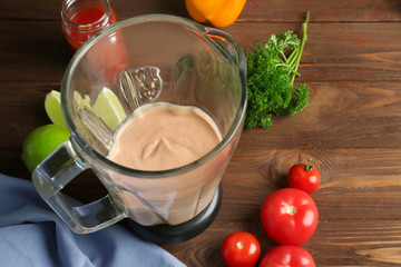 Tasty creamy tomato sauce for fish taco in blender on kitchen table