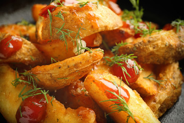 Delicious baked potato wedges, close up