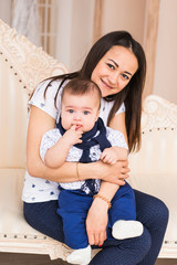 Adorable Caucasian baby boy with his mother. Portrait of a three months old infant boy