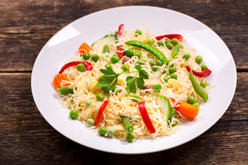 plate of noodles with vegetables