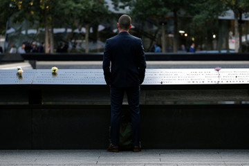 A man pauses at the edge of the South reflecting pool at the National September 11 Memorial and Museum during ceremonies marking the 16th anniversary of the September 11, 2001 attacks in New York