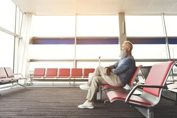 Joyous smiling elder man locating in airport