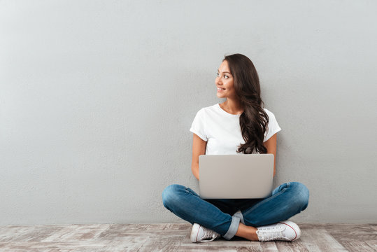 Attractive asian woman holding laptop computer