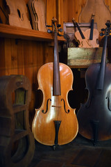 Cellos standing in luthier workshop