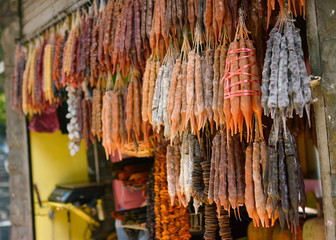 a lot of fruit sweets weighs and is sold in the market