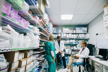 Medical staff discussing in hospital pharmacy