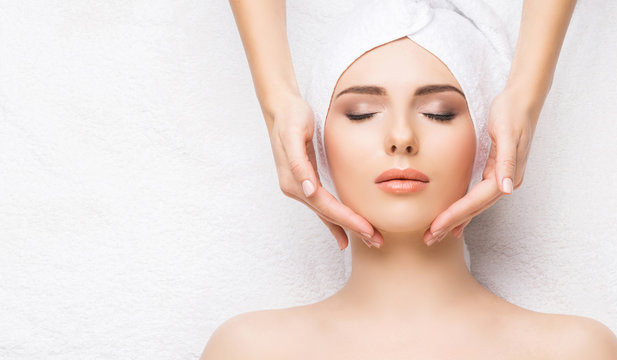 Woman getting face massage treatment. Person in spa. Healthcare, healing, and medicine concept.