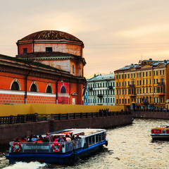 St Petersburg. Old residential buildings and touristic boats at Moyka river