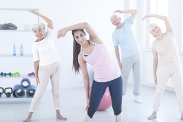 Young instructor and elderly people