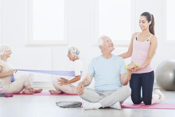Elderly person lifting dumbbel