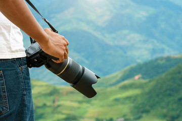 photographer taking camera for adventure travel in natural view