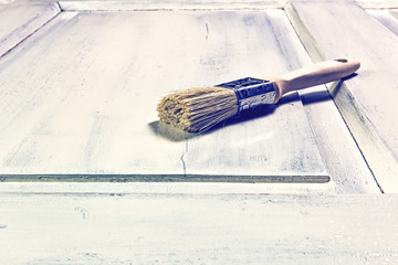 Painting a door with a brush