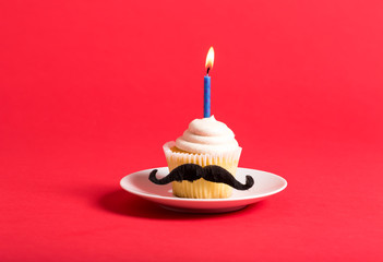 Cupcake with a moustache in Father's Day theme