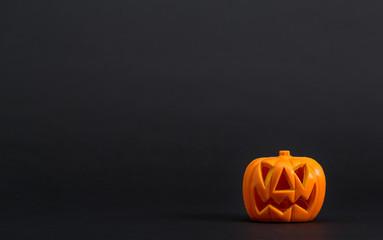 Halloween pumpkin decorations on a black background