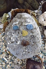 primitive sculpture of a face made of rock, coral, stone and coconuts on Drunk Bay, St. John, USVI, US Virgin Islands, Caribbean