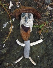 primitive culpture of a figure made of rock, coral, stone and coconuts on Drunk Bay, St. John, USVI, US Virgin Islands, Caribbean