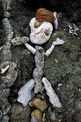 primitive sculpture of a figure made of rock, coral, stone and coconuts on Drunk Bay, St. John, USVI, Virgin Islands, Caribbean