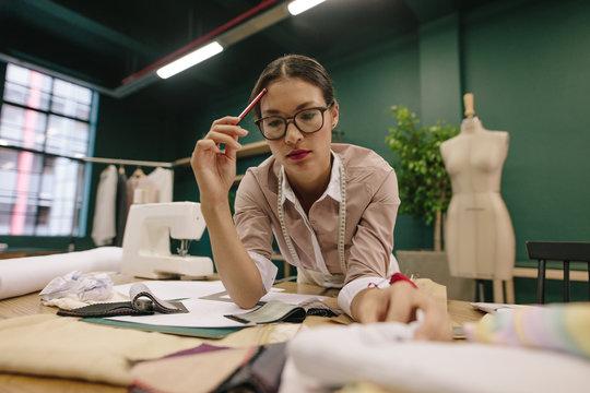 Woman dressmaker working in her studio